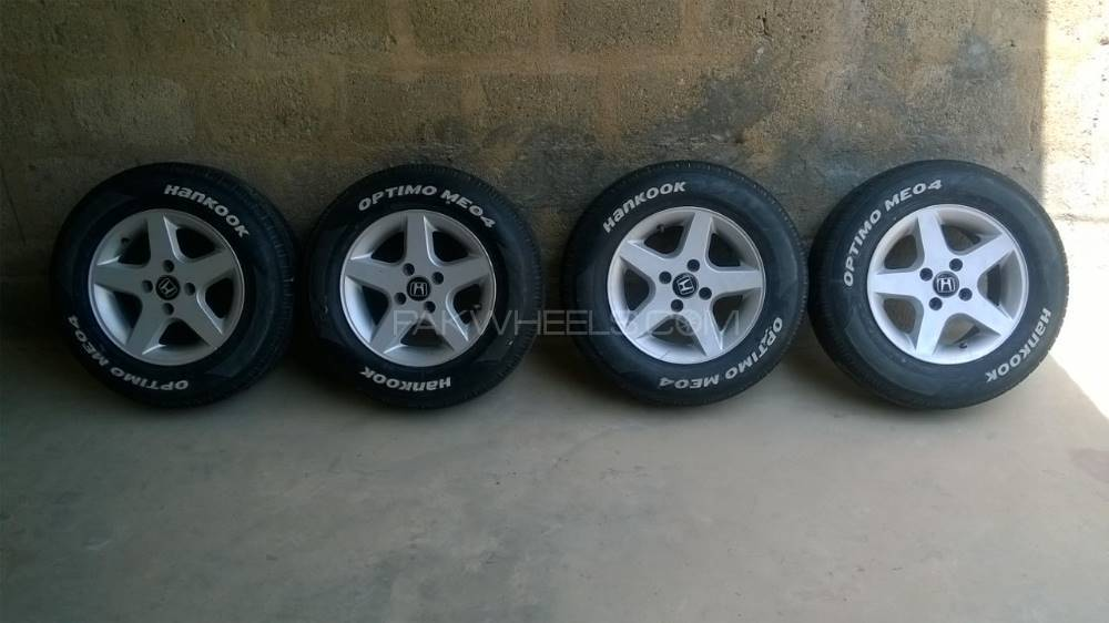 "13"" Alloy Wheels with Tyres Image-1"