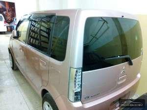 Slide_mitsubishi-ek-wagon-mx-2011-13297755