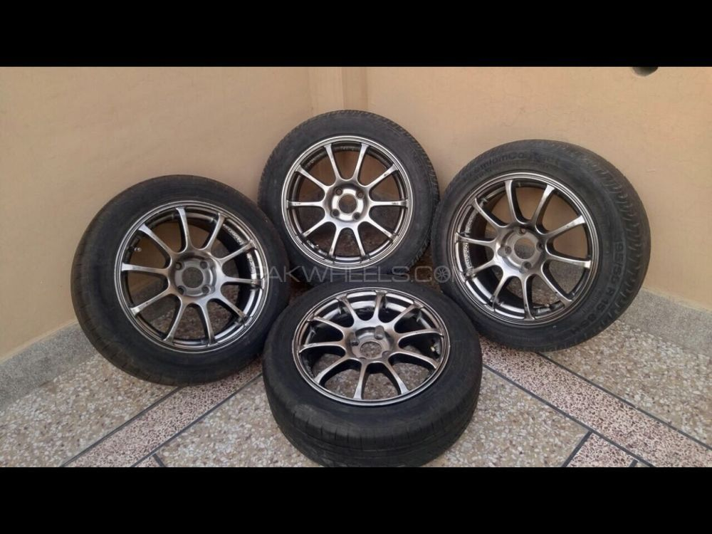 15 inch ALMOST BRAND NEW RIMS WITH TYRES.. Image-1