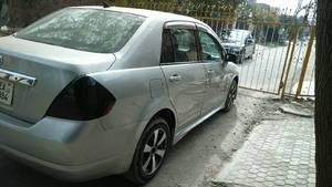 Slide_nissan-tiida-2012-15265265
