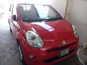 Slide_toyota-passo-1-0-plus-hana-2012-15306624