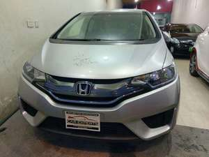 Slide_honda-fit-hybrid-f-package-2013-16200224