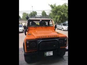Slide_land-rover-defender-90-2011-16564198