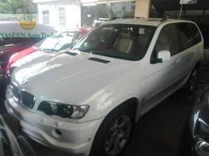 Slide_bmw-3-series-330i-2003-17894282