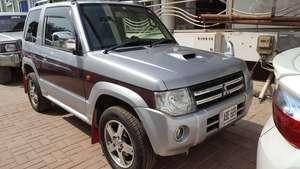 Slide_mitsubishi-pajero-mini-xr-2011-17932133