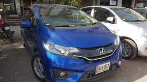 Slide_honda-fit-hybrid-f-package-2015-18410934