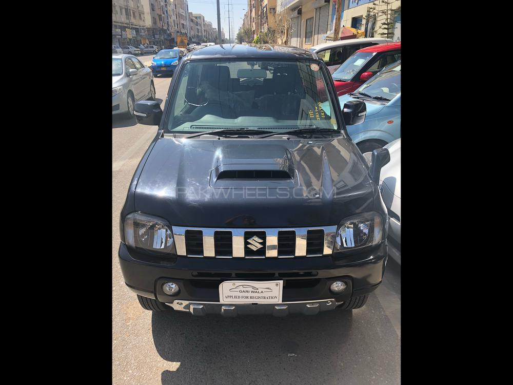 ®GARIWALA® Suzuki Jimny, 660C.c, Pearl Black,  X-Adventure Salmon Package,  Fully Automatic Transmission, Model 2012, Fresh cleared/import 2018, Original 68,000 K.M ( Verifiable ),  Original 3.5 Grade Auction sheet ( verifiable ), Original Complete Option 2WD, 4WD, 4WD-L, Complete Central Locking, Key Start, Power Windows,  Auto-Retractable Mirrors, Heated Seat, Power-steering, Kenwood CD/MP3/USB player,  ABS Braking System,  Original Safety Air-Bags, Original Japanese Tyre,  Traction Control, Genuine/ Guarantee.