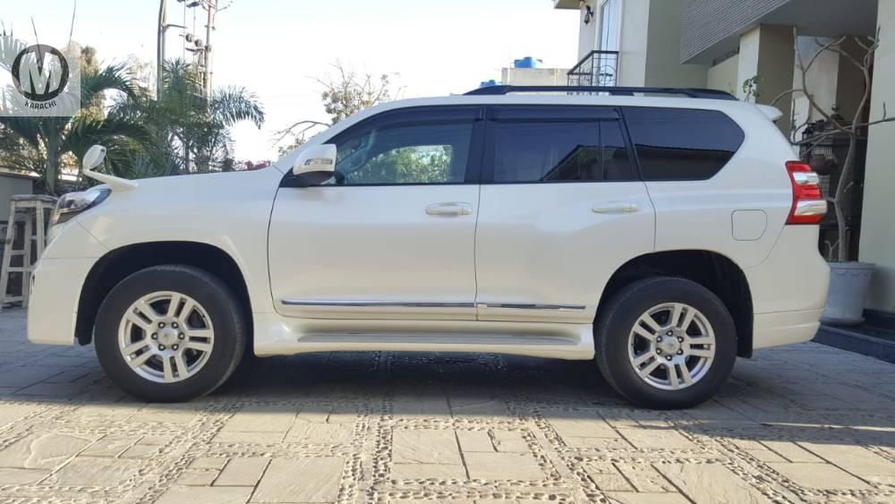 TOYOTA PRADO TZ-G,  MODEL 2012, REGISTER 2017.  *FACE LIFT WITH BODY KIT* *HIGHT CONTROL* *MEMORY SEATS* *ELECTRIC SEATS* *LEATHER SEATS* *WOODEN STEERING* *CRUISE* *HEATED SEATS* *AFTER MARKET ORIGINAL T.V* *7 SEATER * *HID AND LED LIGHTS* *FIRST OWNER*  Merchants Automobile Karachi Branch,  We Offer Cars With 100% Original Auction Report Based Cars With Money Back Guarantee.  Recommended Tips To Buy Japanese Vehicle:   1. Always Check Auction Report.  2. Verify Auction Report From Someone Else.  3. Ask For Japan Yard Pics If Possible.   MAY ALLAH CURSE LIARS..