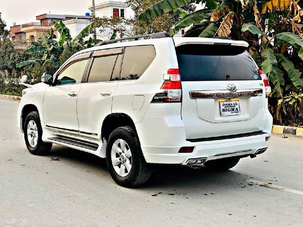 Toyota Land Cruiser Prado TX New Shape New Meter Model 2014 Import 2020 (February) Un-Registered  Engine 2700 cc  Millage 53,000 km original  Auction Grade 4.5 Verified  Auction sheet Attached  Bumper to Bumper original Pearl White with Beige Room 7 Seater with sunroof  Beige Room  Beautiful jeep,Excellent Condition Modify with Trd Accessories. Original pics are also attached .Very care fully driven .Total Original.  Extra Accessories Full Multimedia Steering  Original DVD with Back view Camera Glass Coat  cruise control  6 Hids 100 watts with 1 year warrenty  Climate Control Dual A/C  Dvd Sound System   Trd Body kit .  Front Back trd Sports Bumper Extensions  Brand New Tire 17 Inch  Matt's original .  Back screen Spoiler  Air press  Complete chrome fitting  Chrome handles Chrome windows trims Chrome door mouldings Back light chrome shield  Key-less Entry . 100% original. Fully maintained through authorized dealership Japan