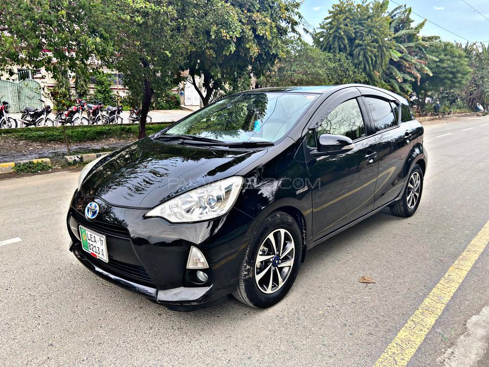 Toyota Aqua G Model Year 2014 Import Year 2017 Registration 2017  Push Start Multimedia Steering Cruise Control Alloy Wheels Led projection Headlamps  DVD TV Back Camera And much more