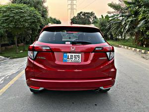 Honda Vezel Z Sensing Electric Memory Seats Edition Cherry Red Color Model Year 2017 Import And Registration 2018 Front Electric Memory Seats Multimedia Steering Adaptive Cruise Control Radar with Distance Monitor Lane Departure Assist with Steering Control Heating Seats  Leather Seats  Low Mileage