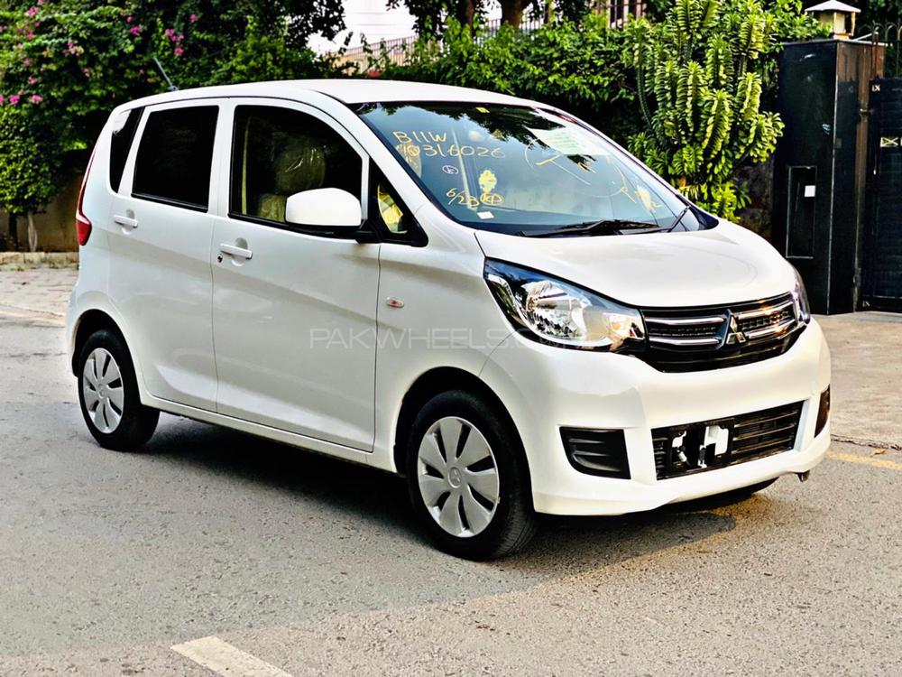 Mitsubishi EK-Wagon  Pearl White Color  2017 Model 2020 Import Un-Registered  HID Projection Lamps  DVD TV 4 Cameras  Leather Steering Climate Control AC Alloy Wheels