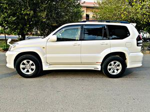 Toyota Land Cruiser Prado TXL 2005/2008 Registration Iahore 2008 Pearl White Model 2008  Contact Hammad  03000300001 03177707777  Auction sheet 4.5 grade verifiable  Auction sheet Attached Engine 2700 cc  Millage 75,000 km original  Bumper to Bumper Original Tesla Tv and dvd with Navigation  2 camera's 7 Seater Sunroof Alloy security key  6 Hids 100 watts from Japan back camera  Climate Control Dual A/C  multimedia Steering with woodeN.  Dvd Sound System  Brand New Tire Back screen Spoiler  Side Panel with Lights Back Led Smoke Lights.  Air press  Chrome handles  Complete chrome fitting  Key-less Entry With Dual Security System.  keys with remote sensor