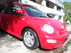 Slide_volkswagen-beetle-2002-7585122