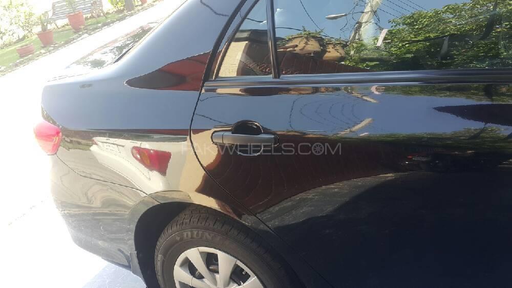 Toyota Corolla - 2012 crolla gli 1.6 auto black colour  Image-1
